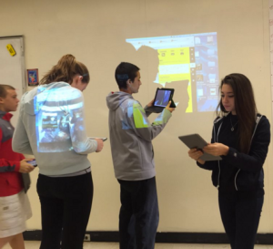 BHS students scanning the Padlet QR code in US History